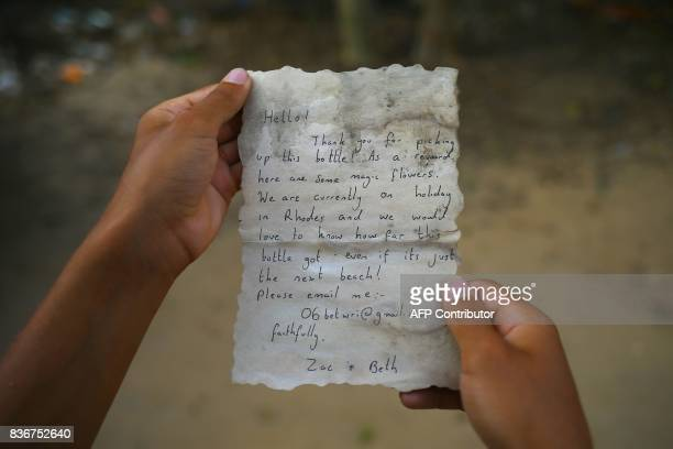 A picture shows the message Palestinian fisherman Jihad alSoltan found in a bottle off a Gaza beach after it was placed in the water last July by two...