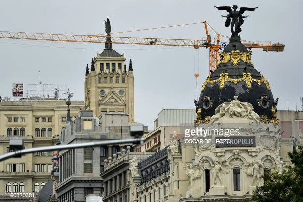 A picture shows the Metropolis building in Madrid on August 7 2019