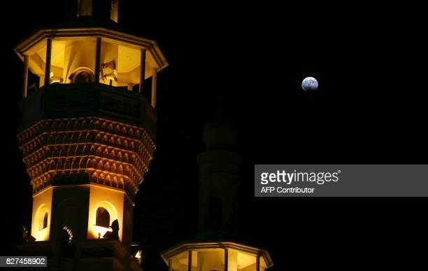 A picture shows the moon during a partial lunar eclipse as seen from Kuwait City on August 7 2017 / AFP PHOTO / Yasser AlZayyat