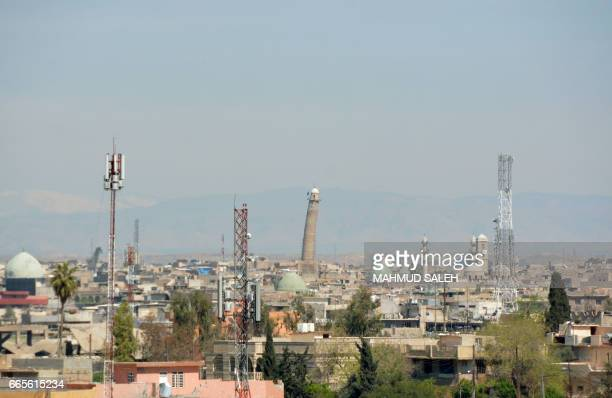 A picture shows the Mosul skyline featuring the historic leaning AlHadba minaret near the Great Mosque of AlNuri in Mosul where Islamic State group...