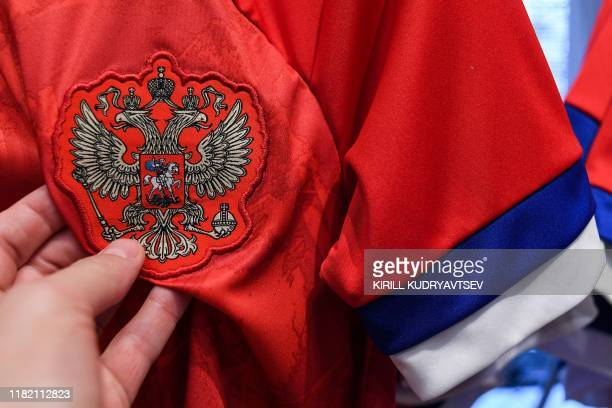 A picture shows the new Adidasdesigned jersey of the Russian national football team at an official Adidas store in Moscow on November 13 2019...