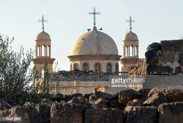 Picture shows the new church of Sayyidet al-Beshara in Shaqra town in the southern Syrian province of Daraa on December 22, 2019. - Less than 10...