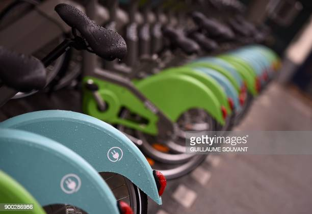A picture shows the new colourful bike models blue for electric and green for manual of Paris' new Velib bicyclesharing service operated by...