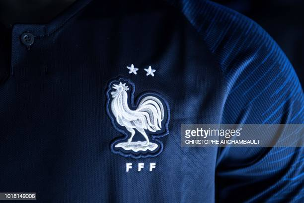 A picture shows the new jersey of the French national football team bearing the two stars of world champion displayed for sale at the French Football...