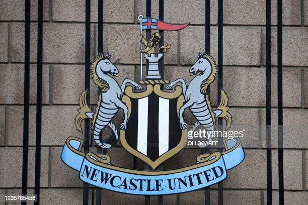 Picture shows the Newcastle United logo outside the club's stadium St James' Park in Newcastle upon Tyne in northeast England on October 8, 2021. - A...