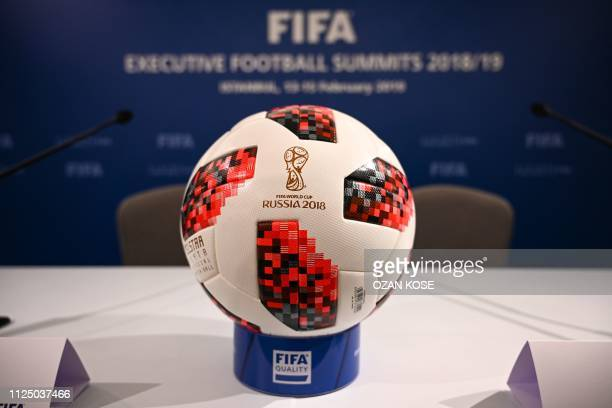 A picture shows the official ball of FIFA World Cup Russia 2018 during a press conference held by the president of the football's governing body at...