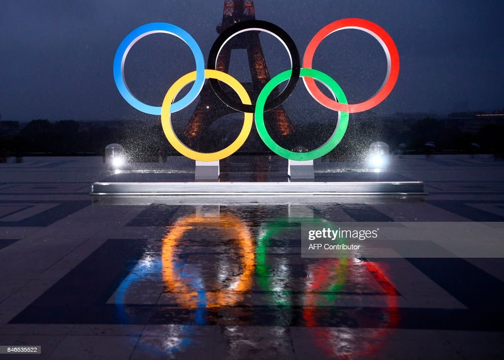 A picture shows the Olympics Rings on the Trocadero Esplanade near the Eiffel Tower in Paris, on September 13, 2017, after the International Olympic Committee named Paris host city of the 2024 Summer Olympic Games. The International Olympic Committee named Paris and Los Angeles as hosts for the 2024 and 2028 Olympics on September 13, 2017, crowning two cities at the same time in a historic first for the embattled sports body. /