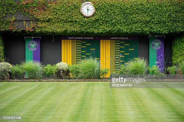 Picture shows the Order of Play boards showing last years winners on the exterior of Centre Court at the All England Lawn Tennis Club in west London...