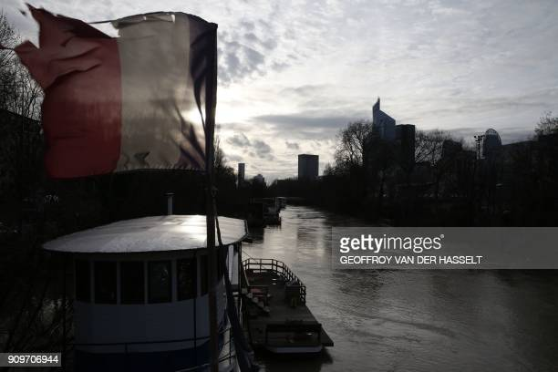 A picture shows the overflowed River Seine on the Ile de la Grande Jatte between NeuillysurSeine and LevalloisPerret west of Paris on January 24 2018...
