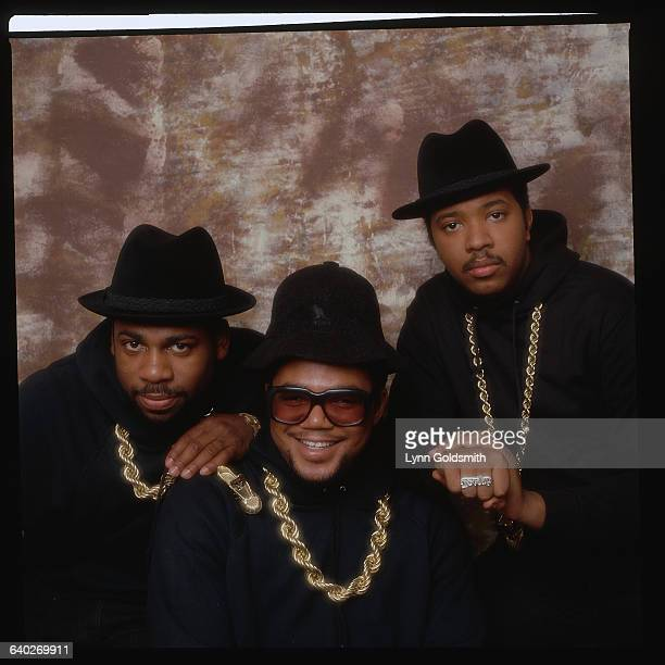 Picture shows the rap group RunDMC posing sidebyside in a studio They are all wearing black sweatshirts and large gold necklaces Undated photo circa...