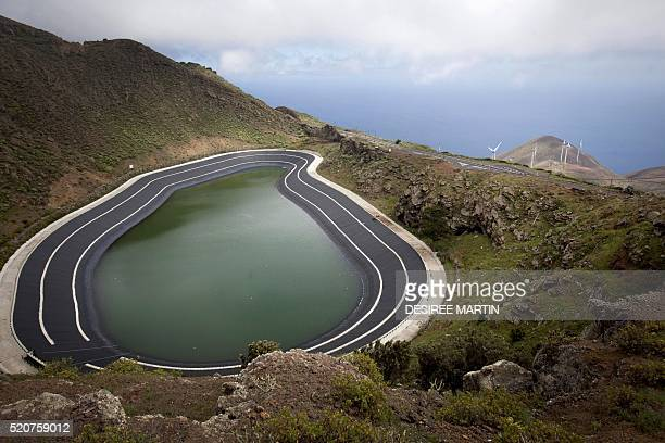 Picture shows the reservoir of the Gorona windhydropumped station on the Spanish Canary island of El Hierro on March 14 2016 Pines and pineapples vie...