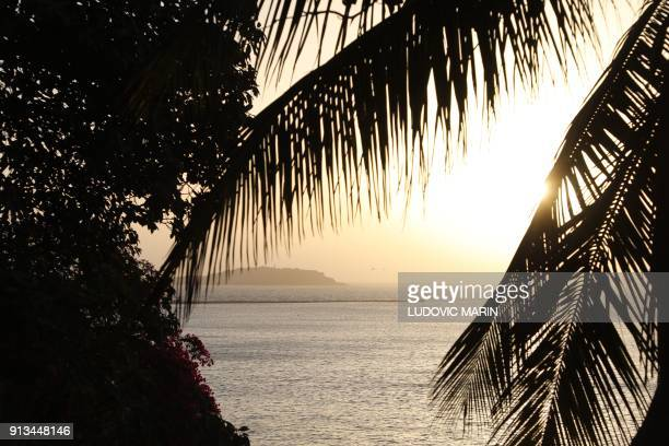 A picture shows the rising sun above Goree Island off the coast of Dakar on February 2 2018 / AFP PHOTO / Ludovic MARIN