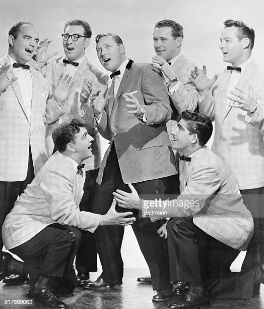 6/1956 Picture shows the rock and roll singing group Bill Haley and the Comets posing together and singing with Bil Haley in the middle with two men...