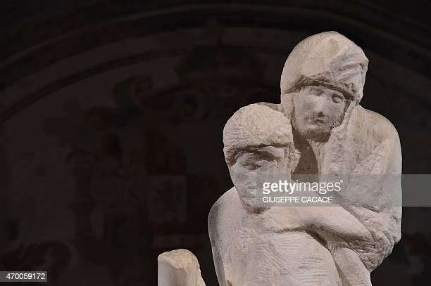 A picture shows the Rondadini Pieta a marble sculpture by Italian artist Michelangelo on April 17 2015 at the Castello Sforzesco in Milan The...