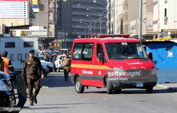 Picture shows the scene of a twin suicide bombing on a bustling commercial street in the heart of Baghdad on January 21, 2021. - The toll in a twin...