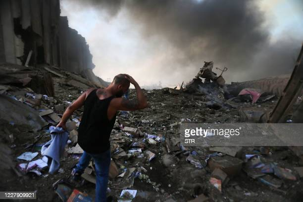 Picture shows the scene of an explosion at the port in the Lebanese capital Beirut on August 4, 2020. - Two huge explosion rocked the Lebanese...