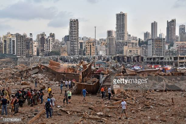 TOPSHOT A picture shows the scene of an explosion near the the port in the Lebanese capital Beirut on August 4 2020 Two huge explosion rocked the...