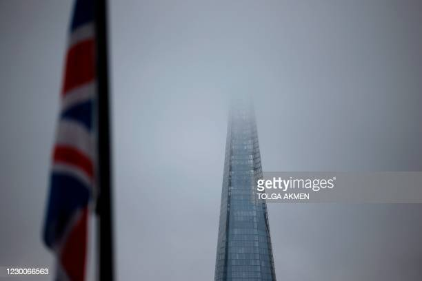 Picture shows The Shard skyscraper disappearing into low cloud in London on December 11, 2020. - A Brexit trade deal between Britain and the European...