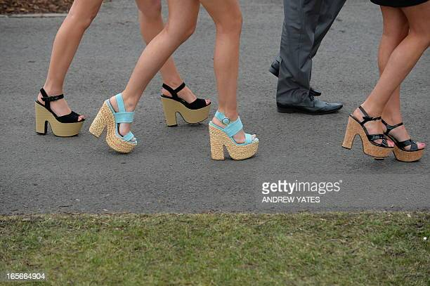 A picture shows the shoes of racegoers on Ladies Day the second day of the Grand National Meeting horse racing event at Aintree Racecourse in...