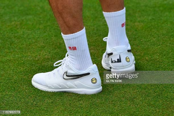 A picture shows the shoes of Switzerland's Roger Federer as his takes part in a practice session at The All England Tennis Club in Wimbledon...