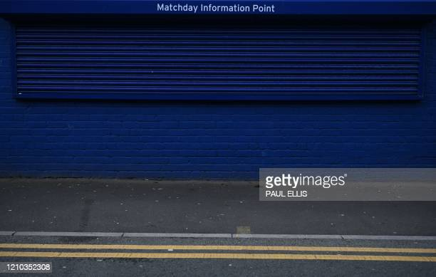 TOPSHOT A picture shows the shuttered Matchday Information Point at Everton football club's stadium Goodison Park in Liverpool northwest England on...