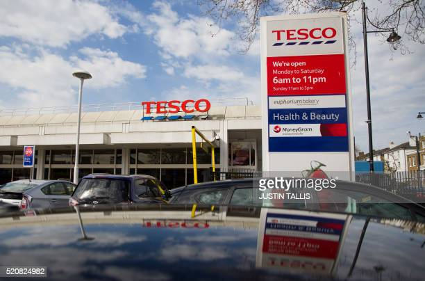 A picture shows the signage at a branch of Tesco supermarket in Brixton south London on April 13 2016 Tesco said on April 13 that it rebounded into...