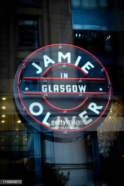 A picture shows the signage at a closeddown Jamie's Italian restaurant in Glasgow on May 21 2019 British celebrity TV chef Jamie Oliver said Tuesday...