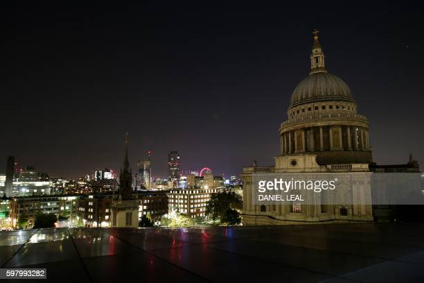 A picture shows the skyline of London at night with St Paul's Cathedral on August 30 2016 / AFP / DANIEL LEALOLIVAS
