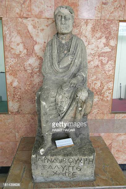 A picture shows the statue of a Greek man sitting on a chair displayed at Aleppo museum 21 March 2006 in Aleppo 350 kilometres north of the Syrian...