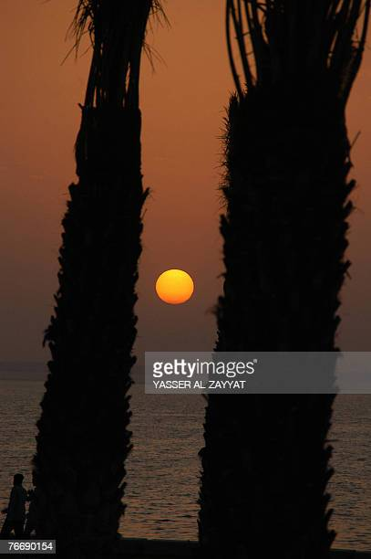 A picture shows the sun setting in Kuwait City 12 September 2007 on the eve of the first day of the holy Muslim fasting month of Ramadan Across much...