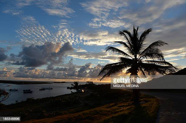 A picture shows the sunrise in the Caribbean island of Saint Martin on October 19 2013 AFP PHOTO / MIGUEL MEDINA