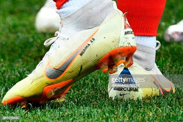 A picture shows the Switzerland and the Kosovo flag on the shoes of Switzerland's forward Xherdan Shaqiri prior to the Russia 2018 World Cup Group E...