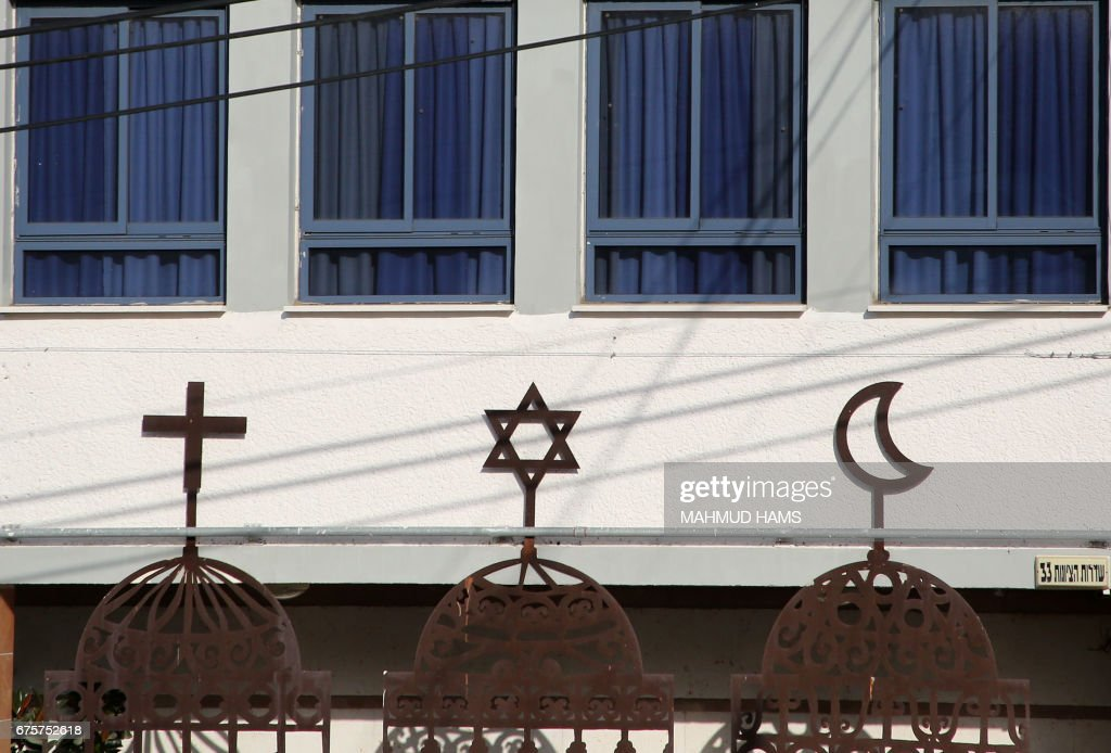 A Picture Shows The Symbols Of The Three Major Monotheistic
