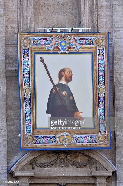A picture shows the tapestry of friar Francescano Nicola Saggio da Longobardi on November 21 2014 at St Peter's basilica in Vatican two days before a...