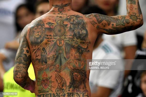 Picture shows the tattoos of Real Madrid's Spanish defender Sergio Ramos at the end of the Spanish league football match between Real Madrid CF and...