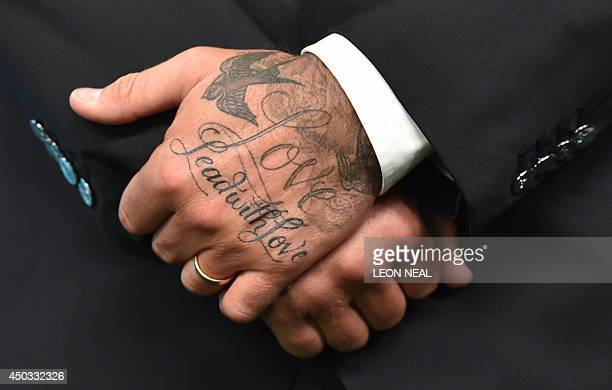 A picture shows the tattoos on the back of one of the hands of former England football player David Beckham as he attends an event to launch the...