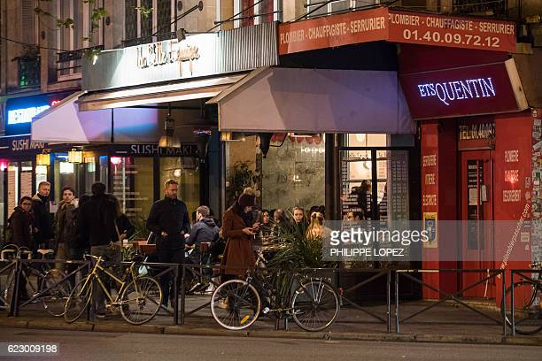 """Picture shows the terrasse of the cafe """"La Belle Equipe"""" in Paris, taken on November 11 a year after the Paris terror attacks. / AFP / PHILIPPE LOPEZ"""