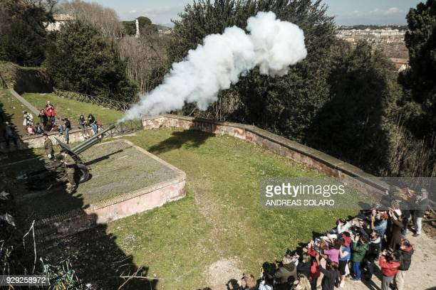 A picture shows the traditional midday cannon shot from the Janiculum hill on March 8 2018 in Rome Since 1847 on the orders of Pius IX a special...