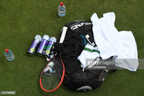 A picture shows the training bag of Czech Republic's Tomas Berdych and a racquet with broken strings as Berdych attends a practice session at The All...