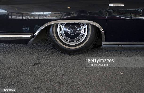 A picture shows the tyre of a 1970 Mercedes 600 Pullman during a classic car show in Tehran on April 28 2011 Classic cars belonging to individuals...