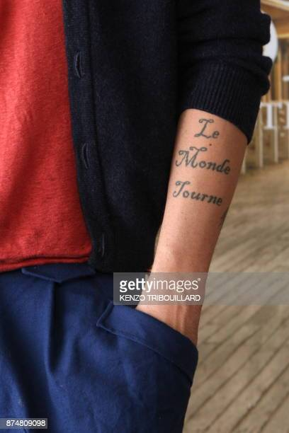 A picture shows the US actor Thomas Dekker's tattoo during the photocall of the movie 'Kaboom' presented out of competition at the 36th American Film...