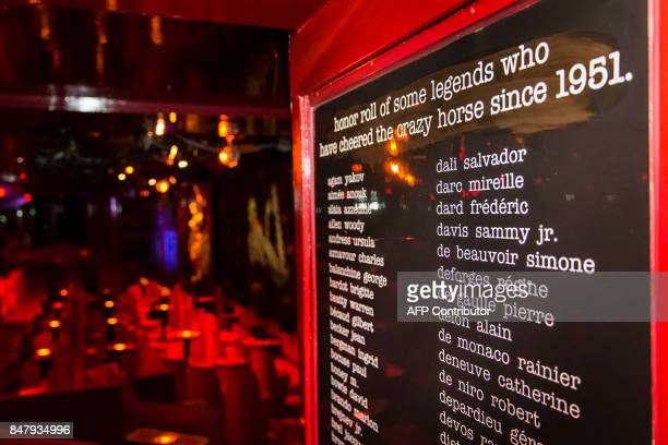A picture shows the wall of fame inside the Parisian cabaret 'Crazy Horse' on September 16 2017 in Paris The famous Parisian cabaret opened its doors...