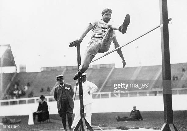 Picture shows the Water Commissioner, Ray Ewry, when he was an athlete in 1908. He is shown leaping over the high jump.