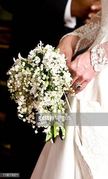 A picture shows the wedding and engagement rings worn by Kate Middleton who has been given the title The Duchess of Cambridge as she holds the...