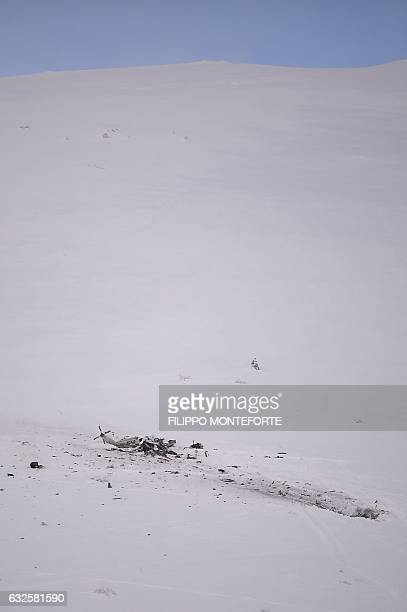 Picture shows the wreck of an helicopter following a crash killing six people, on January 24, 2017 in the mountains near the ski resort of Campo...