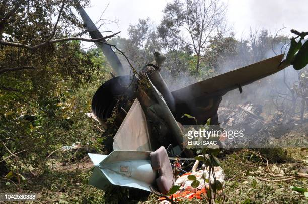 A picture shows the wreckage of one of the two Nigerian Air Force fighter jets that crashed during a rehearsals ahead of the nation's independence...