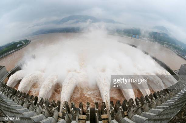 Picture shows this year's biggest release of water from the sluice for flood prevention at the Three Gorges Dam in Yichang, central China's Hubei...