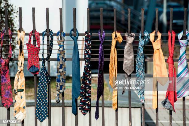 A picture shows ties hanged on the fence of the Kosovo government headquarters in Pristina on December 26 2017 Around 300 ties were collected and...