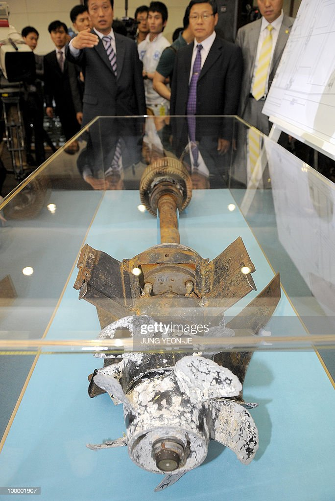 A picture shows torpedo parts salvaged from the Yellow Sea during a press conference at the Defense Ministry in Seoul on May 20, 2010. South Korea's president vowed 'resolute countermeasures' against North Korea after investigators concluded that it sank one of Seoul's warships with the loss of 46 lives. A multinational team investigating the March 26 sinking of the 1,200-tonne corvette said a torpedo fired by a North Korean submarine was to blame.