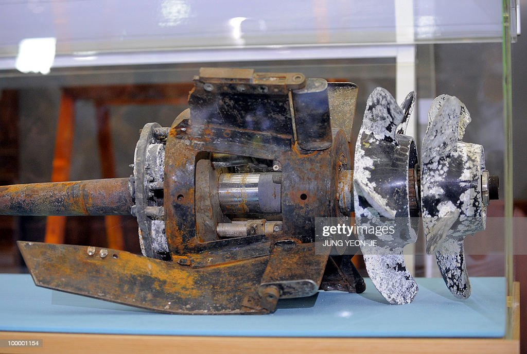 A picture shows torpedo parts salvaged from the Yellow Sea shown during a press conference at the Defense Ministry in Seoul on May 20, 2010. South Korea's president vowed 'resolute countermeasures' against North Korea after investigators concluded that it sank one of Seoul's warships with the loss of 46 lives. A multinational team investigating the March 26 sinking of the 1,200-tonne corvette said a torpedo fired by a North Korean submarine was to blame.
